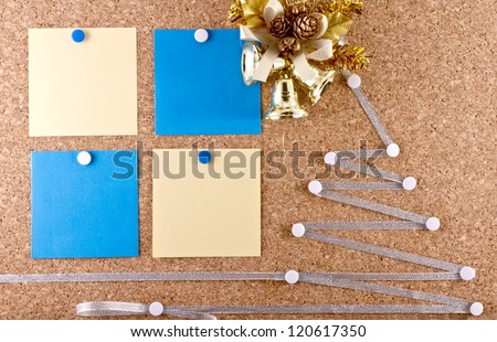 Cork-board with a New Year resolutions empty paper notes, Christmas wreath and improvised silver Christmas tree/New year\'s resolutions cork-board