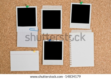 Cork board with blank instant photos and notes - stock photo