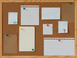 cork board with blank papers wooden frame. notes. colourful pin and paperclips . reminder. pin board. isolated. new year's resolution, goals.