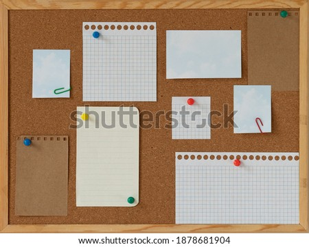 Photo of  cork board with blank papers wooden frame. notes. colourful pin and paperclips . reminder. pin board. isolated. new year's resolution, goals.