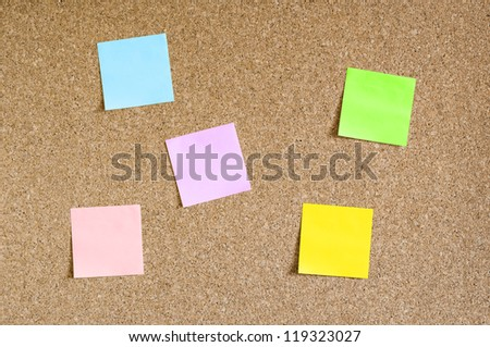 Cork board with colorful sticky notes