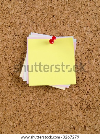 Cork-board with colour memo notes and pin