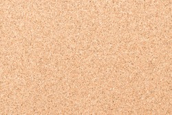 Cork board with corkboard texture background brown grainy backdrop for blank bullentin, advertisment, memo notice or noticeboard announcement