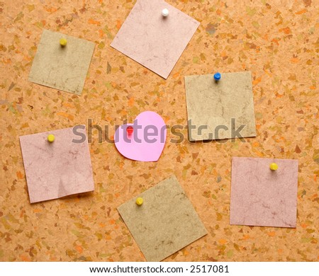 Cork board with heart shape sticky note stock photo for Heart shaped bulletin board