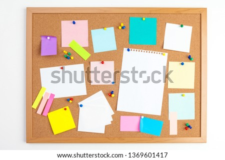 Cork board with several colorful blank notes with pins Stock photo ©