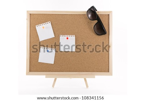 cork board with three white note and sunglasses