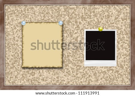 Cork bulletin board with note and instant photo card.