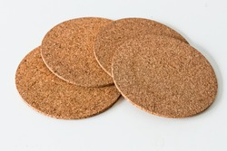 Cork coaster with white background. Top view.