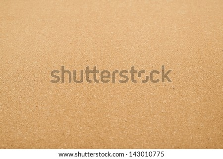 Cork mat surface as a background composition with a shallow depth of field