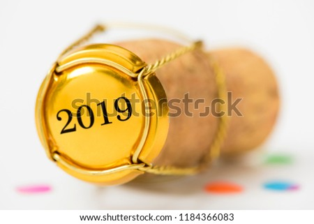 cork stopper of champagne with new year`s date 2019 and copy space #1184366083