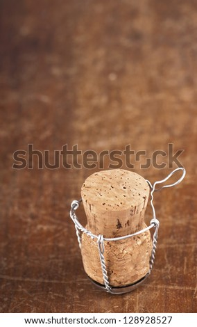 Cork-stopper of champagne/  Wooden Background - stock photo