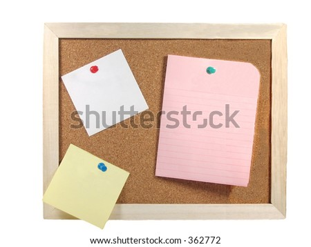 Corkboard with blank paper in pink, white, yellow