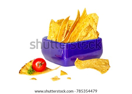 Corn chips nachos in a blue square ceramic bowl, cherry tomato and parsley on a white background. Side view. Isolated #785354479