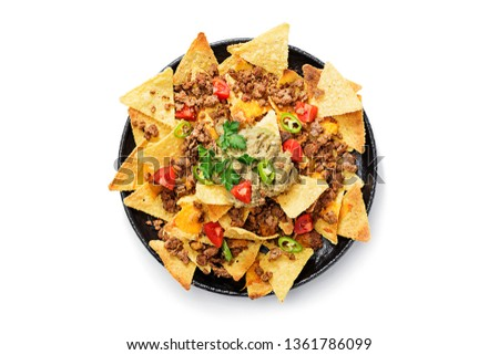 Corn chips nachos with fried minced meat and guacamole isolated on white background. Foto stock ©