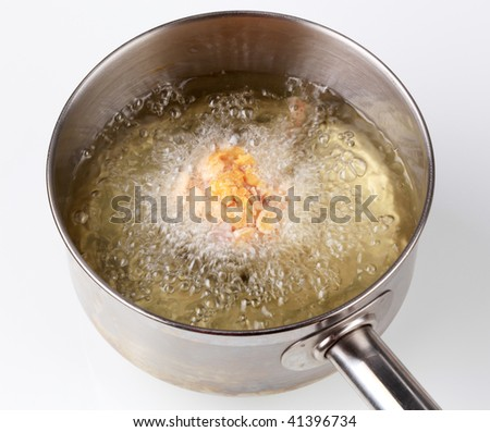 Corn flake chicken drumstick being deep fried