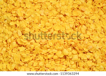 Corn-flakes background and texture. Top view. cornflake cereal box for morning breakfast. #1139363294