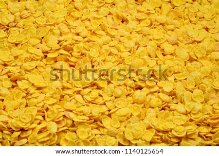 Corn-flakes background and texture. Top view. cornflake cereal box for morning breakfast. #1140125654