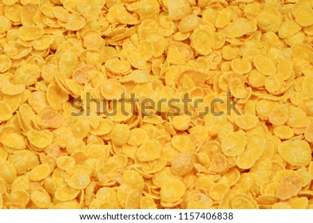 Corn-flakes background and texture. Top view. cornflake cereal box for morning breakfast. #1157406838