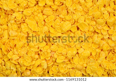 Corn-flakes background and texture. Top view. cornflake cereal box for morning breakfast. #1169131012