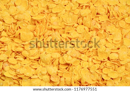 Corn-flakes background and texture. Top view. cornflake cereal box for morning breakfast. #1176977551