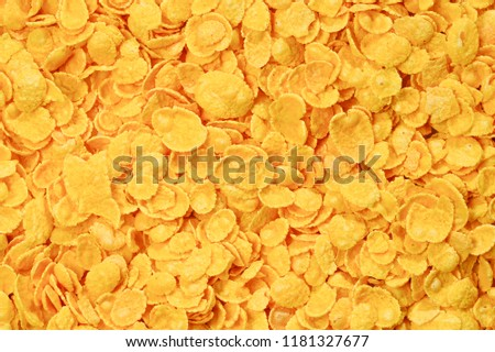 Corn-flakes background and texture. Top view. cornflake cereal box for morning breakfast. #1181327677