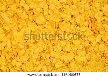 Corn-flakes background and texture. Top view. cornflake cereal box for morning breakfast. #1191400555