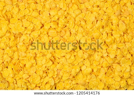 Corn-flakes background and texture. Top view. cornflake cereal box for morning breakfast. #1205414176