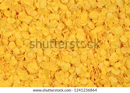 Corn-flakes background and texture. Top view. cornflake cereal box for morning breakfast. #1241236864