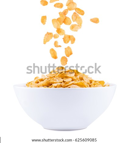 Corn flakes falling to the bowl #625609085