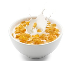 corn flakes with milk splash isolated on white