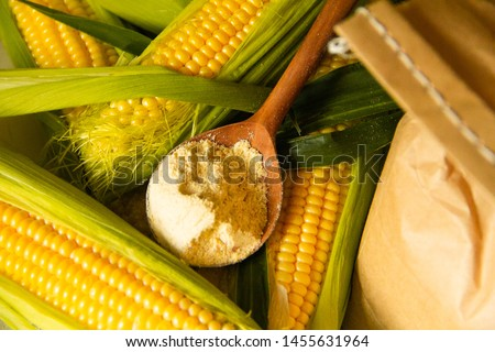 Corn flour with corn on the background.