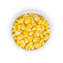 Corn in white bowl isolated on white background. Top view.