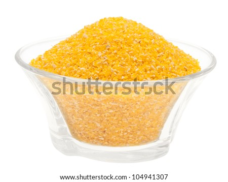Corn meal in a glass bowl. On a white background.