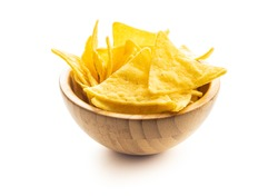 Corn nacho chips. Yellow tortilla chips in wooden bowl isolated on white background.