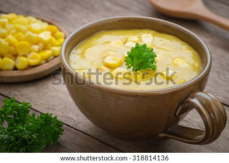 Corn soup in bowl and sweet corn on plate