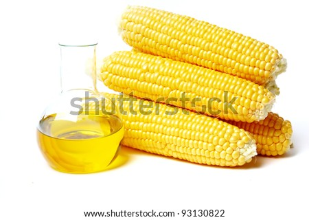 Corn with oil isolated on white