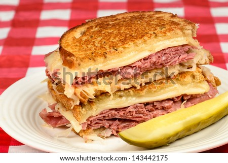 stock-photo-corned-beef-reuben-sandwich-fresh-corned-beef-on-grilled-rye-with-melted-swiss-and-sauerkraut-143442175.jpg
