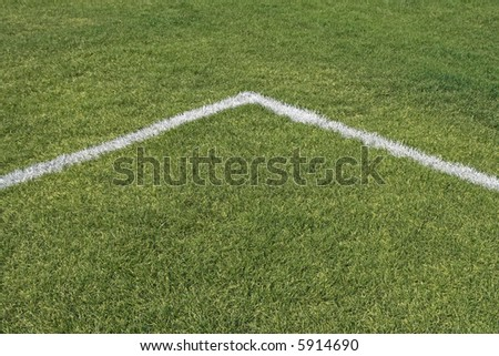 Corner boundary lines of a green grass playing field.