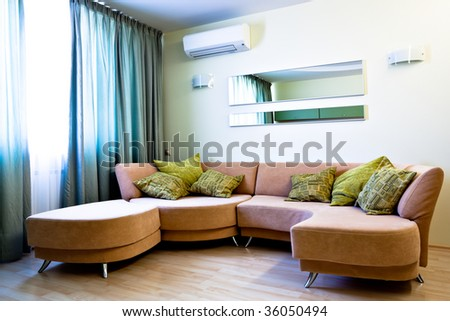 Corner in modern studio interior with sofa