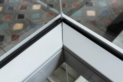 Corner joint of a window pvc frame with a rubber gasket or seal. Shot from inside.