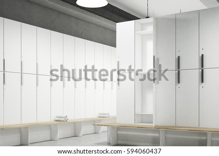 Shutterstock Corner of a locker room with gray walls, a row of wooden storage lockers near the wall and a bench with rolled towels on it. 3d rendering. Mock up.