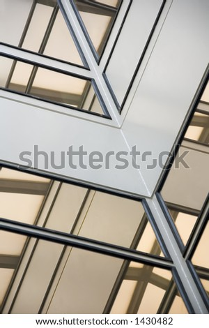 Corner of atrium with windows reflecting skylight stock for Where to buy atrium windows