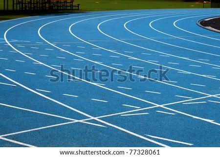 Corner of blue running track