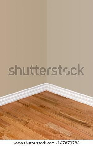Corner of empty bedroom with view of hardwood floor, baseboard and walls