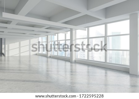 Corner of empty panoramic industrial style office with white walls, concrete floor, row of lamps and windows with blurry cityscape. Concept of real estate. 3d rendering