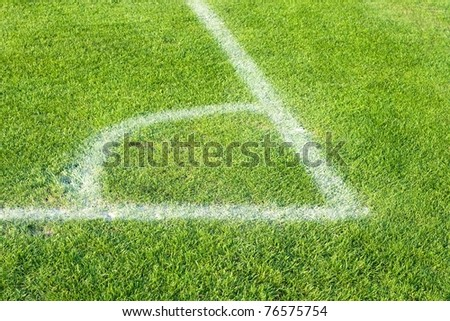 Corner of green soccer field with white border