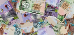 Corner of Kuwaiti 10 Dinar Banknotes for background.