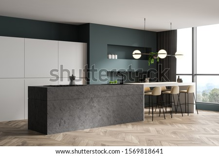 Corner of luxury kitchen with green walls, wooden floor, stone island with built in sink and cooker, white cupboards and bar with beige stools. 3d rendering