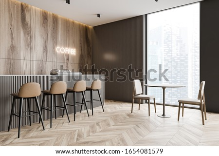 Corner of minimalistic coffee shop with wooden and grey walls, wooden floor, bar counter with brown stools and glowing coffee sign and round table with chairs. 3d rendering