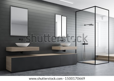 Corner of modern bathroom with gray walls, concrete floor, double sink with mirrors, gray cabinet and shower with glass walls. 3d rendering